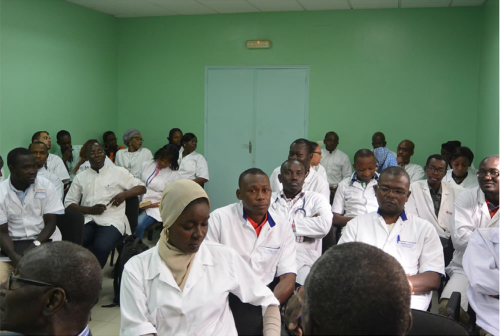 Neurology residents at the University of Dakar in a feedback session withWFN site visitors.